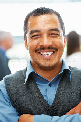 Buy stock photo Portrait of smiling executive with people in background