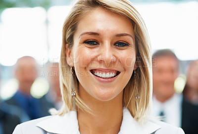 Buy stock photo Closeup of pretty businesswoman with team in distance