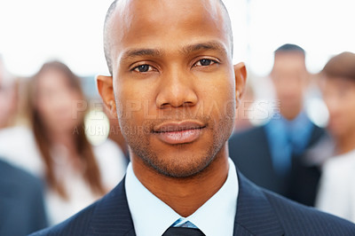 Buy stock photo Closeup of handsome executive with peers in distances