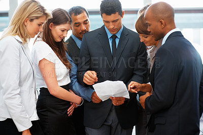 Buy stock photo Executives having a discussion indoors