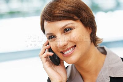 Buy stock photo Closeup of young executive having phone conversation