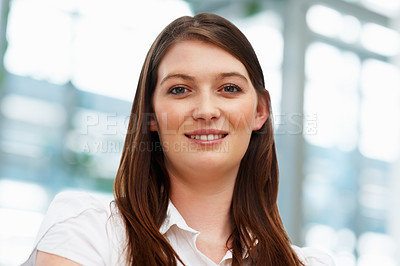 Buy stock photo Young female executive looking directly at you
