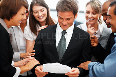 Buy stock photo View of colleagues waiting for results while executive reads report