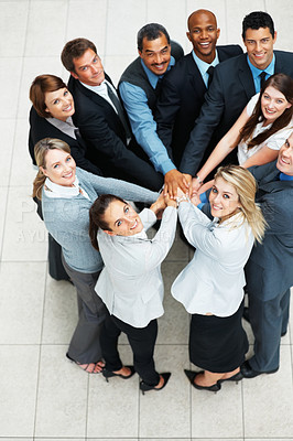 Buy stock photo Top view of business people with hands piled on top