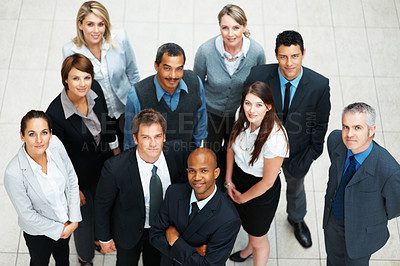 Buy stock photo High angle view of successful business people looking up