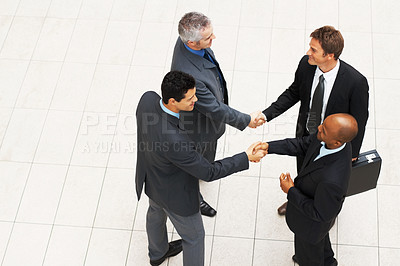 Buy stock photo High angle view of business men shaking hands