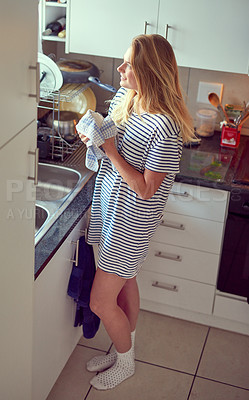 Keeping her kitchen tidy