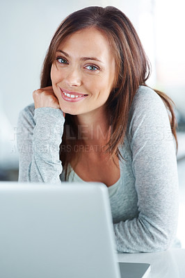 Buy stock photo Portrait of a pretty young woman smiling with a laptop