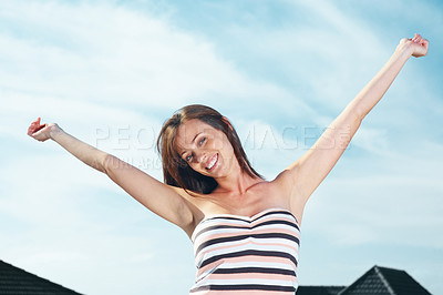 Buy stock photo Portrait of a gorgeous young woman smiling with raised hands against the sky - Outdoor