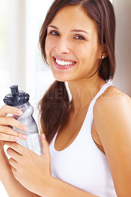 Buy stock photo Closeup portrait of a fitness woman holding a water bottle and smiling