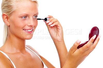 Buy stock photo Portrait of pretty young woman applying mascara using lash brush over white background