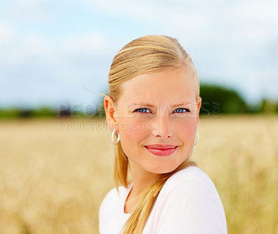 Buy stock photo Closeup of a confident blond woman smiling at a field