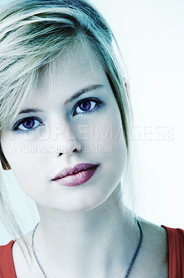 Buy stock photo Portrait of a beautiful young woman With a cool blue tint.