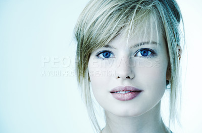 Buy stock photo Portrait of a beautiful young woman. With a cool blue tint.