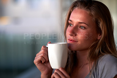 Buy stock photo Closeup portrait of a thoughtful young woman having a hot cup of coffee at home - Indoor