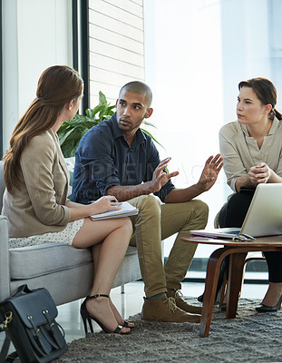Buy stock photo Shot of a group of colleagues having a meeting at work