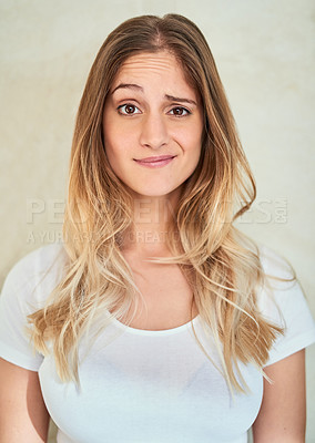 Buy stock photo Portrait of a young woman making a face in studio