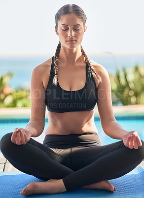 Buy stock photo Shot of an attractive young woman meditating outside