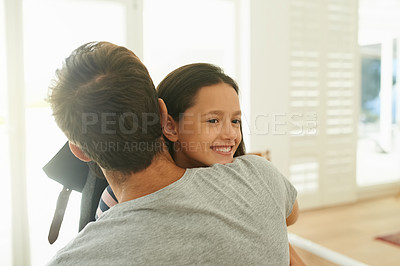 Buy stock photo Cropped shot of a little girl hugging her father