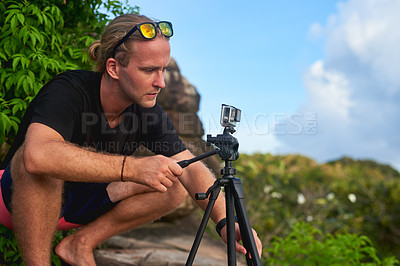 Buy stock photo Cropped shot of a young man using his camera outside