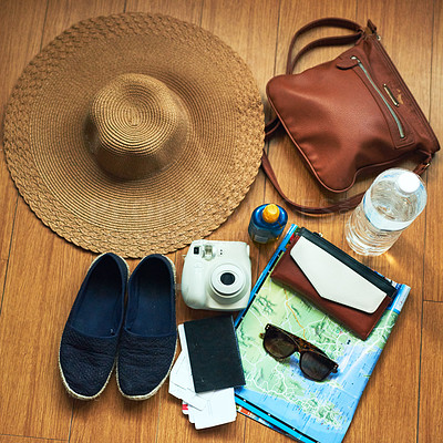 Buy stock photo High angle shot of travelling essentials on a table