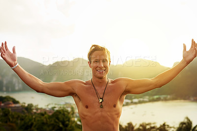 Buy stock photo Portrait of a happy young man admiring a tropical view while on holiday