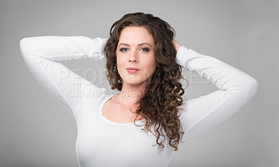 Buy stock photo Studio portrait of a beautiful young woman against a gray background