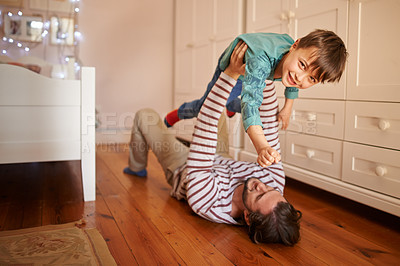 Buy stock photo Full length shot of a young father and his son playing at home