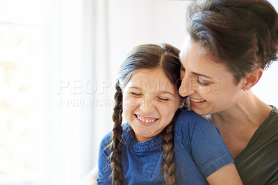 Buy stock photo Cropped shot of a young mother and her daughter bonding at home
