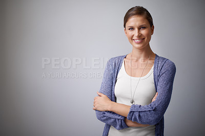 Buy stock photo Portrait of an attractive young woman against a grey background