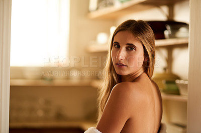 Buy stock photo Shot of a young woman relaxing in her bathrobe at home
