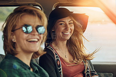 Buy stock photo Portrait of two young friends enjoying a roadtrip together