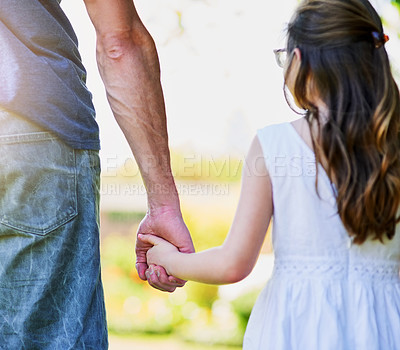 Buy stock photo Rear view shot of a little girl holding her father's hand outside