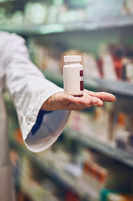 Buy stock photo Cropped shot of a pharmacist recommending medication