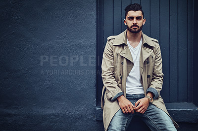 Buy stock photo Portrait of a fashionable young man wearing urban wear and posing against a gray background