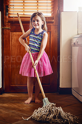 Buy stock photo Portrait of a little girl mopping the floor at home