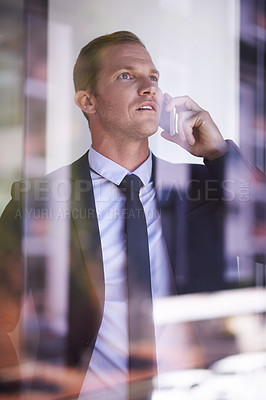 Buy stock photo Shot of a businessman using his mobile phone to make a call at work