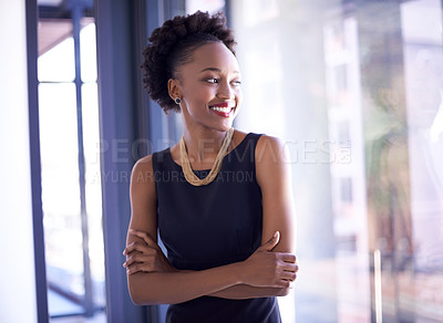Buy stock photo Shot of a confident and successful young businesswoman working in a modern office