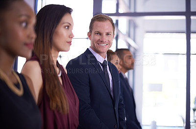 Buy stock photo Shot of a businessman standing out from his colleagues