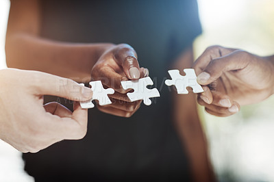 Buy stock photo Cropped shot of a work group connecting pieces of a puzzle