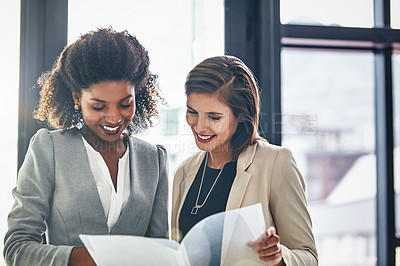 Buy stock photo Cropped shot of two businesswomen having a discussion in an office