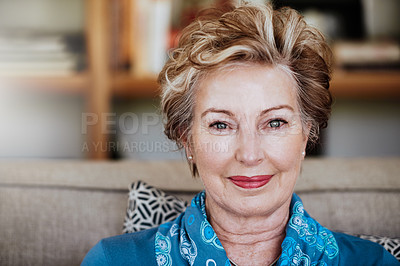 Buy stock photo Portrait of an attractive senior woman relaxing on the sofa at home