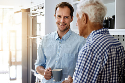 Buy stock photo Cropped shot of a man and his elderly father drinking coffee together at home