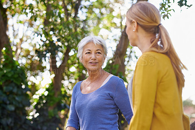 Buy stock photo Shot of a mother and daughter taking a walk outside