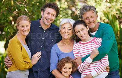 Buy stock photo Shot of a family posing for a photograph outdoors
