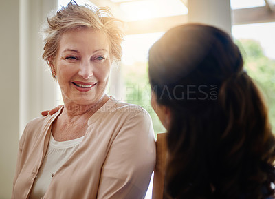 Buy stock photo Shot of a smiling senior woman talking with a nurse in assisted living facility