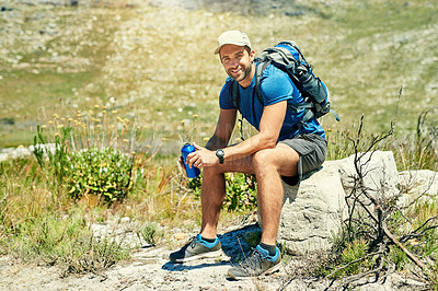 Buy stock photo Portrait of a young man taking a break while out on a hike