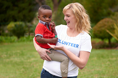 Buy stock photo Shot of volunteers working with little children