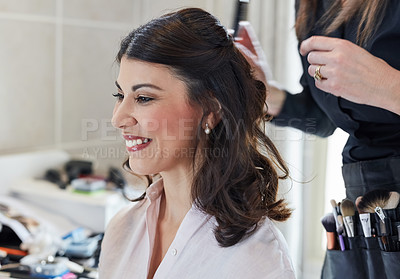 Buy stock photo Shot of a beautiful bride getting her makeup and hair done by her stylist artist