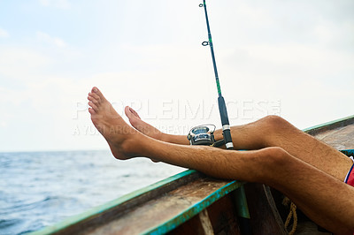Buy stock photo Cropped shot of a young man fishing